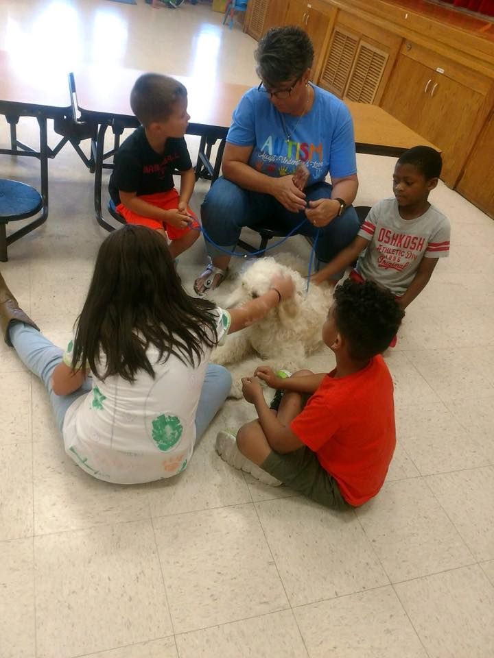 Tracy and Students with Service Dog