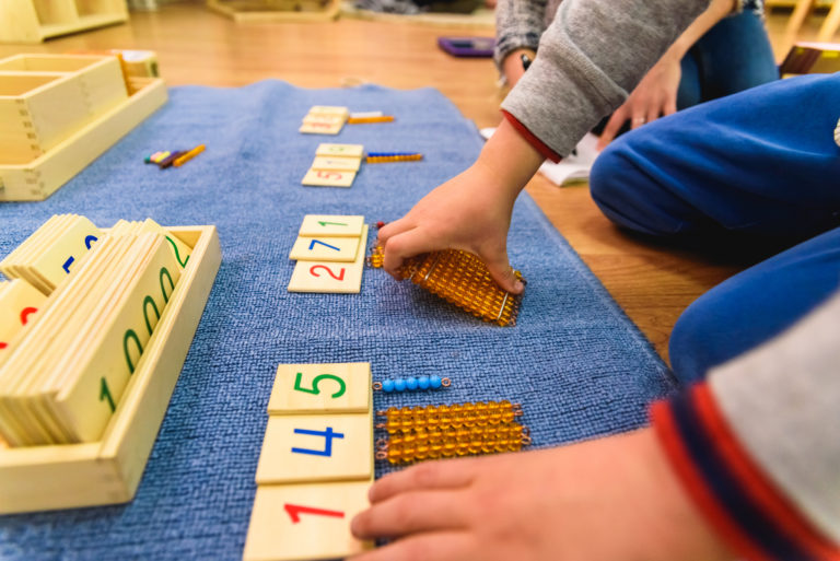 Hands of a student using Montessori material